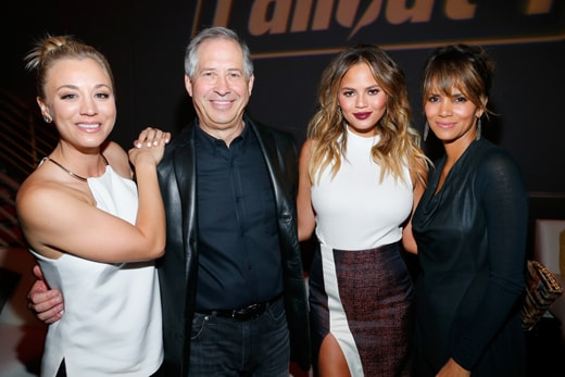 LOS ANGELES, CA - NOVEMBER 05: (L-R) Actress Kaley Cuoco, ZeniMax Media Chairman/CEO Robert A. Altman, model Chrissy Teigen, and actress Halle Berry attend the Fallout 4 video game launch event in downtown Los Angeles on November 5, 2015 in Los Angeles, California. (Photo by Rich Polk/Getty Images for Bethesda)