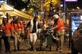 Medics-evacuate-an-injured-person-on-Boulevard-des-Filles-du-Calvaire-in-Paris