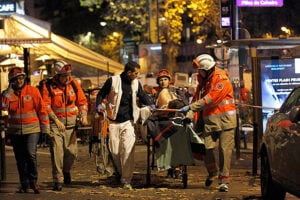 Medics-evacuate-an-injured-person-on-Boulevard-des-Filles-du-Calvaire-in-Paris