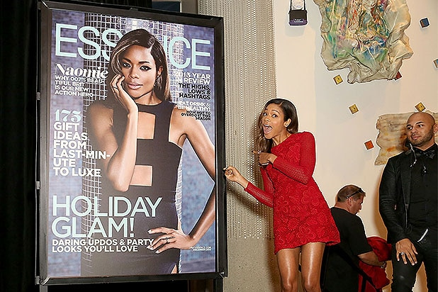 LOS ANGELES, CA - NOVEMBER 03: Essence Magazine's Regina Robertson (L)reveals Essence Magazine's latest cover of Bond Actress and honoree Naomie Harris during the Black Women of Bond Tribute at the California African American Museum on November 3, 2015 in Los Angeles, California. (Photo by Rachel Murray/Getty Images for THAurban)