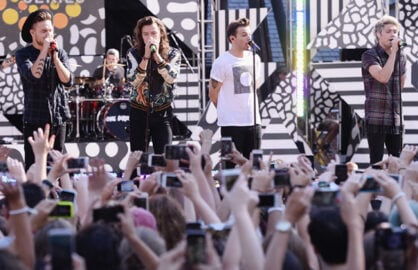 "NEW YORK, NY - AUGUST 04:  (L-R)  Liam Payne, Harry Styles, Louis Tomlinson, and Niall Horan of One Direction perform on ABC's ""Good Morning America"" at Rumsey Playfield, Central Park on August 4, 2015 in New York City.  (Photo by Stephen Lovekin/Getty Images)"