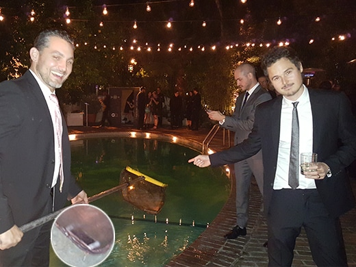 Eric Ray Davidson Phone in Pool GQ Men of the Year Party