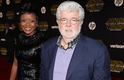 HOLLYWOOD, CA - DECEMBER 14: Filmmaker George Lucas (R) and Mellody Hobson attend the premiere of Walt Disney Pictures and Lucasfilm's 'Star Wars: The Force Awakens' at the Dolby Theatre on December 14th, 2015 in Hollywood, California. (Photo by Ethan Miller/Getty Images)
