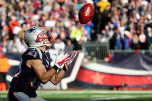 An New England Patriots prepares to catch a football
