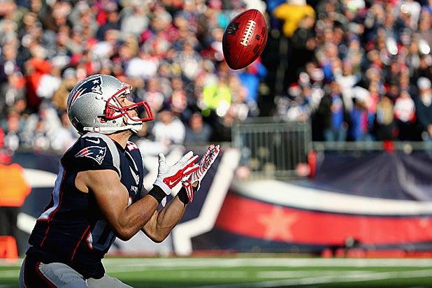 An New England Patriots prepares to catch a football