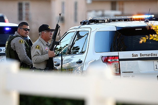 SAN BERNARDINO, CA - DECEMBER 02: Law enforcement hold a position along Mountain View Avenue as they pursue suspects of the shooting at the Inland Regional Center on December 2, 2015 in San Bernardino, California. Police continue to search for suspects in the shooting that left at least 14 people dead and another 17 injured (Photo by Sean M. Haffey/Getty Images)