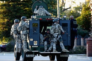 SAN BERNARDINO, CA - DECEMBER 02: SWAT officers enter an area where suspects were believed to be after the shooting at the Inland Regional Center on December 2, 2015 in San Bernardino, California. Police continue to search for suspects in the shooting that left at least 14 people dead and another 17 injured. (Photo by Sean M. Haffey/Getty Images)