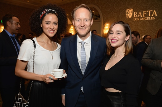 LOS ANGELES, CA - JANUARY 09: (L-R) Actress Nathalie Emmanuel, British Consul General in Los Angeles Chris O'Connor, and actress Emilia Clarke attend the BAFTA Los Angeles Awards Season Tea at Four Seasons Hotel Los Angeles at Beverly Hills on January 9, 2016 in Los Angeles, California. (Photo by Michael Kovac/Getty Images for The GREAT Britain Campaign)