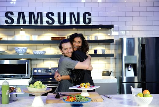 PARK CITY, UT - JANUARY 25: Chef Marcel Vigneron plates and offers Aluna Francis of AlunaGeorge the perfect bite showcasing Samsung Black Stainless Steel home appliances in the Samsung Studio Café during the Sundance Film Festival 2016 on January 25, 2016 in Park City, Utah. (Photo by Neilson Barnard/Getty Images for Samsung)
