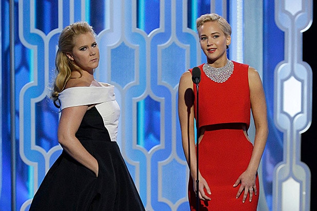 Amy Schumer and Jennifer Lawrence at Golden Globe Awards 2016