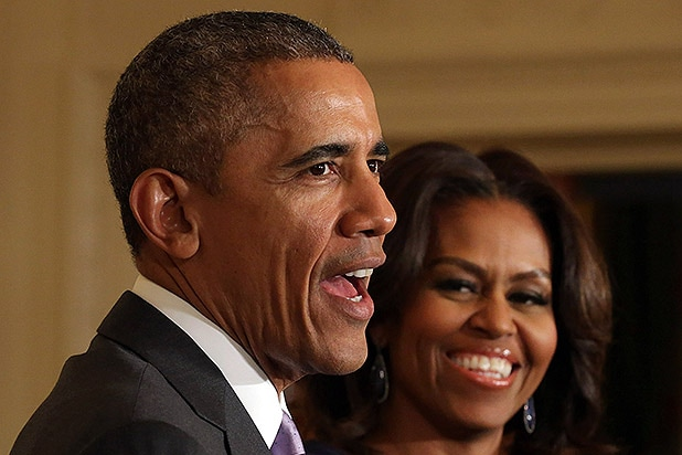 WASHINGTON, DC - MARCH 03: U.S. President Barack Obama (L) and first lady Michelle Obama announce a new government-wide coordinated strategy to help millions of girls around the world attend and stay school called 'Let Girls Learn' in the East Room of the White House March 3, 2015 in Washington, DC. Saying that she will focus on this program beyond her time in the White House, Michelle Obama will soon travel to Japan and Cambodia to promoted the new initiative. (Photo by Chip Somodevilla/Getty Images)