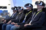 Attendees participate in a Samsung virtual reality experience