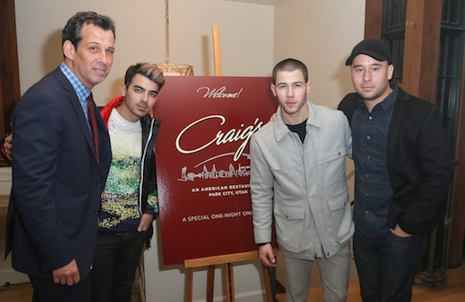 "PARK CITY, UT - JANUARY 23: (L-R) Craig Susser,Joe Jonas,Nick Jonas and Phil McIntyre attend the Phil McIntyre And V Magazine Toast Nick Jonas And His Film ""Goat"" At A Special One Night Craig's Restaurant Pop-up In Sundance - 2016 Park Cityon January 23, 2016 in Park City, Utah. (Photo by John Parra/Getty Images)"