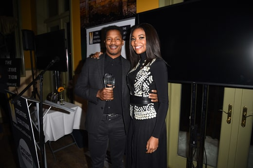 PARK CITY, UT - JANUARY 23: Actors Nate Parker (L) and Gabrielle Union attend the Creative Coalition Spotlight Initiative Awards Gala Dinner at Cisero's Bar on January 23, 2016 in Park City, Utah. (Photo by Nicholas Hunt/Getty Images)