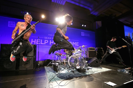 LOS ANGELES, CA - JANUARY 10: (L-R) Flea, Anthony Kiedis, Chad Smith and Josh Klinghoffer of the Red Hot Chili Peppers perform onstage at the 4th Annual Sean Penn & Friends HELP HAITI HOME Gala Benefiting J/P Haitian Relief Organization on January 10, 2015 in Los Angeles, California. (Photo by Christopher Polk/Getty Images for J/P Haitian Relief Organization)