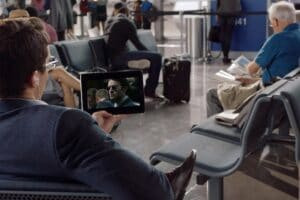 A man streams a Netflix show in an airport