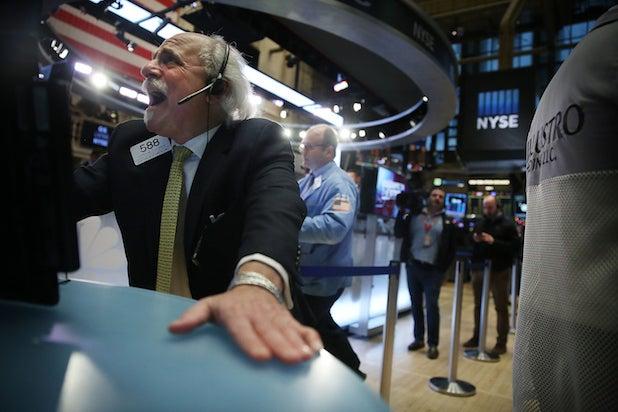 A stock trader yells on the exhange floor media stocks