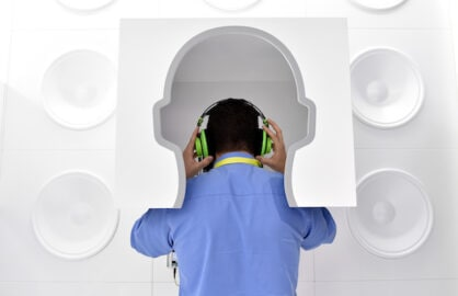 A man listens to streaming subscription music on a pair of headphones