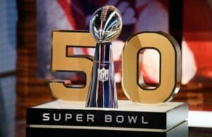 The Vince Lombardi Trophy stands n front of the No. 50, the number of the Super Bowl following the upcoming season, during a media availability at the NFL Network studios, Wednesday, Sept. 9, 2015, in Culver City, Calif. (AP Photo/Danny Moloshok)