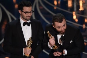 Singer Sam Smith (R) and Composer Jimmy Napes accept their award for Best Song, Spectre on stage at the 88th Oscars on February 28, 2016 in Hollywood, California. AFP PHOTO / MARK RALSTON / AFP / MARK RALSTON        (Photo credit should read MARK RALSTON/AFP/Getty Images)