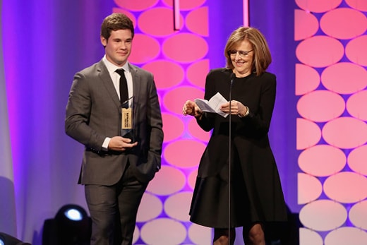 BEVERLY HILLS, CA - FEBRUARY 08: Writer Nancy Meyers (R) accepts the Best Comedy award for 'The Intern' from actor Adam Devine onstage at the AARP's 15th Annual Movies For Grownups Awards at the Beverly Wilshire Four Seasons Hotel on February 8, 2016 in Beverly Hills, California. (Photo by Gabriel Olsen/Getty Images for AARP)