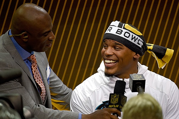 Cam Newton and Deion Sanders at Super Bowl 50 Media Night