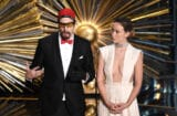 HOLLYWOOD, CA - FEBRUARY 28:  Actors Sacha Baron Cohen (L) and Olivia Wilde speak onstage during the 88th Annual Academy Awards at the Dolby Theatre on February 28, 2016 in Hollywood, California.  (Photo by Kevin Winter/Getty Images)