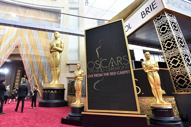 People mingle by Academy Award statuettes on display at Oscars on Sunday, Feb. 28, 2016, at the Dolby Theatre in Los Angeles. (Photo by Jordan Strauss/Invision/AP)