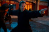 "A character in ""Crouching Tiger, Hidden Dragon: Sword of Destiny"" strikes a martial arts pose"