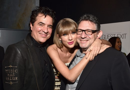 LOS ANGELES, CA - FEBRUARY 15: (L-R) Founder of Big Machine Records Scott Borchetta, singer-songwriter Taylor Swift and CBE Chairman & CEO UMG Lucian Grainge attend Universal Music Group 2016 Grammy After Party presented by American Airlines and Citi at The Theatre at Ace Hotel Downtown LA on February 15, 2016 in Los Angeles, California. (Photo by Lester Cohen/Getty Images for Universal Music Group)