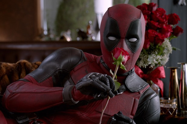 "A still from an ad for ""Deadpool,"" showing the title character holding a rose"