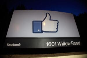 "Facebook's thumbs-up ""like"" logo on a sign at its headquarters"