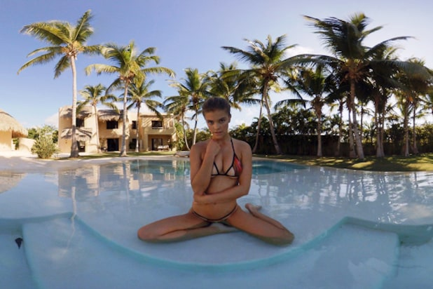 A model poses in virtual reality for Sports Illustrated's swimsuit issue