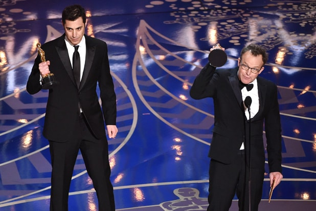 Screenwriter Josh Singer (L) and screenwriter-director Tom McCarthy accept the Best Original Screenplay award for 'Spotlight' onstage during the 88th Annual Academy Awards at the Dolby Theatre on February 28, 2016 in Hollywood, California