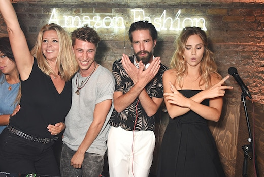 LONDON, ENGLAND - JULY 23: Jack Guinness (2R) and Suki Waterhouse (R) dance in the DJ booth with guests at the Amazon Fashion Photography Studio launch party, which opened on July 23, 2015 in London, England. Guest of honour was Suki Waterhouse, Amazon Fashion face for AW15 and special guest DJ, Jack Guinness. (Photo by David M. Benett/Dave Benett/Getty Images for Amazon Fashion)