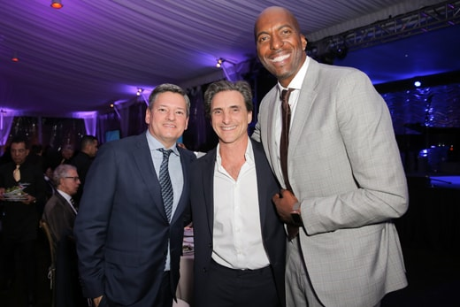 Honoree Ted Sarandos, Lawrence Bender, and host John Salley. (Getty Images)