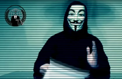 A screenshot of an Anonymous hackivist in a Guy Fawkes mask