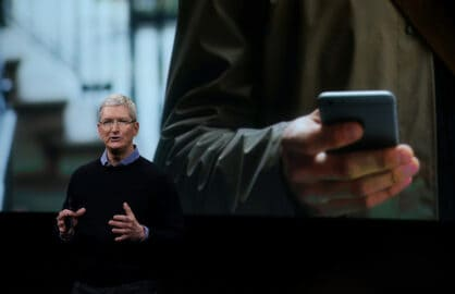 Apple CEO Tim Cook speaks at an Apple iPhone event