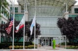 Flags fly at half staff following the death of Steve Jobs at the Apple headquarters