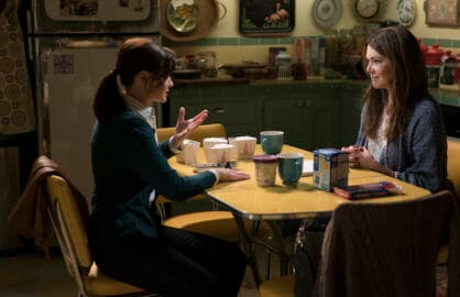 "Characters Lorelei and Rory sit in their kitchen in Netflix's revival of ""Gilmore Girls"""