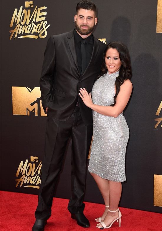 TV personality Jenelle Evans (L) and David Eason attend the 2016 MTV Movie Awards at Warner Bros. Studios on April 9, 2016 in Burbank, California