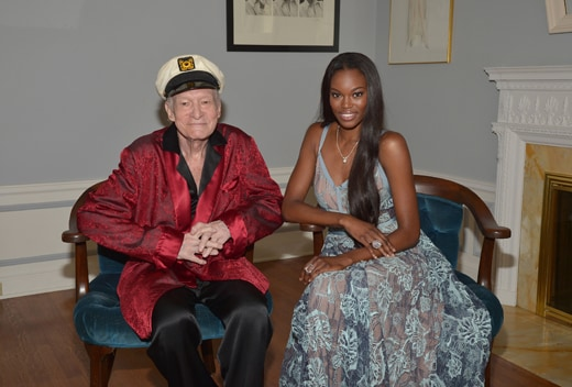 """LOS ANGELES, CA - MAY 11: Playboy Founder and Editor-In-Chief Hugh M. Hefner poses with 2016 Playmate of the Year Eugena Washington at Playboy's 2016 Playmate of the Year Announcement at the Playboy Mansion on May 11, 2016 in Los Angeles, California. (Photo by Charley Gallay/Getty Images for Playboy)"""
