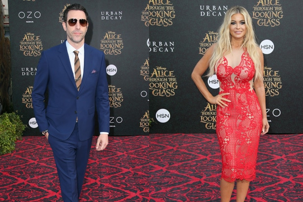 Sacha Baron Cohen and Carmen Electra Alice Through the Looking Glass