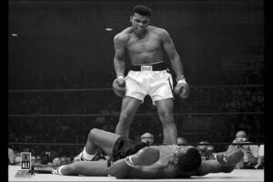 Muhammad Ali defeats Sonny Liston for heavyweight champion