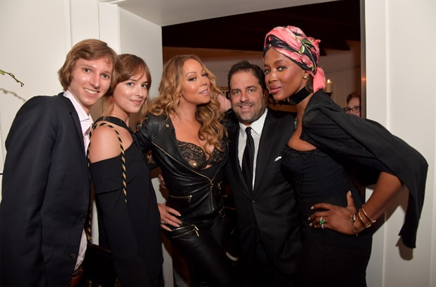 LOS ANGELES, CA - AUGUST 10: (L-R) Nuclear physicist Taylor Wilson, actress Dakota Johnson, Mariah Carey, host Brett Ratner, and model Naomi Campbell attend the special event for UN Secretary-General Ban Ki-moon hosted by Brett Ratner and David Raymond at a Private Residence on August 10, 2016 in Los Angeles, California. (Photo by Lester Cohen/Getty Images for Arise Pictures)