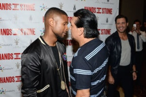 LOS ANGELES, CA - AUGUST 15: Actor/singer Usher Raymond (L) and former professional boxer Roberto Duran attend The Weinstein Company's HANDS OF STONE special screening hosted at The Grove in Los Angeles on August 15, 2016 in Los Angeles, California. (Photo by Matt Winkelmeyer/Getty Images for The Weinstein Company)