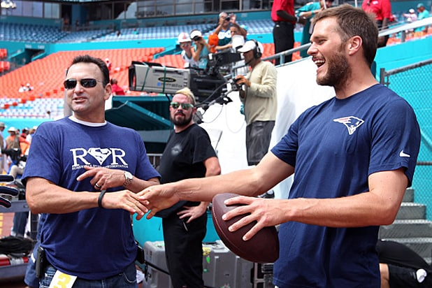MIAMI GARDENS, FL - SEPTEMBER 7: Patriots quarterback Tom Brady says hello to player agent Drew Rosenhaus, left, as he leaves the field after some pre- game warmups. The New England Patriots visited the Miami Dolphins for a season opening regular season NFL game at Sun Life Stadium. (Photo by Jim Davis/The Boston Globe via Getty Images)