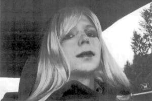 FILE - In this undated file photo provided by the U.S. Army, Pfc. Chelsea Manning poses for a photo wearing a wig and lipstick. Attorneys for the transgender soldier imprisoned in Kansas for sending classified information to the anti-secrecy website WikiLeaks said Monday, July 11, 2016, her hospitalization last week was due to an attempted suicide. (U.S. Army via AP File)