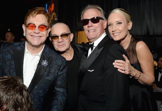 Elton John, Bernie Taupin, actor Peter Fonda, and Margaret DeVogelaere