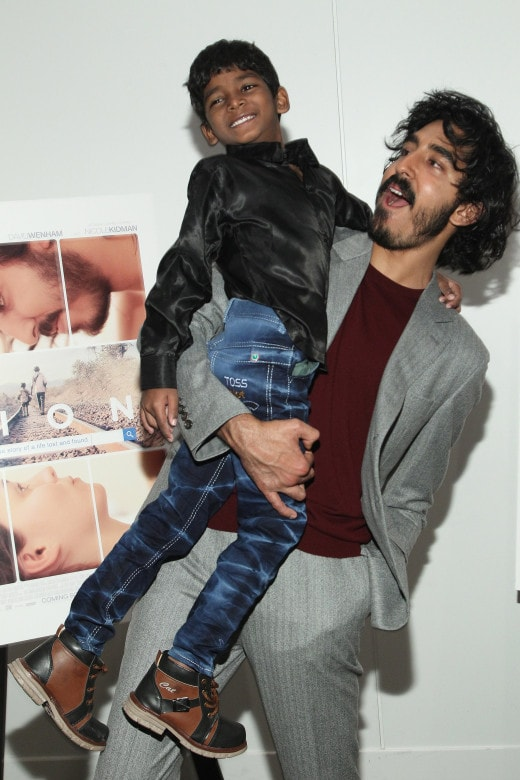 """BEVERLY HILLS, CA - NOVEMBER 22: Sunny Pawar and Dev Patel attend the """"LION"""" LA Special Screening on November 22, 2016 in Beverly Hills, California. (Photo by Tommaso Boddi/Getty Images for TWC - Dimension Films)"""